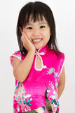 Chinese Little Girl wearing Cheongsam with greeting gesture Stock Photos