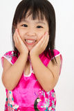 Chinese Little Girl wearing Cheongsam with greeting gesture Stock Photography
