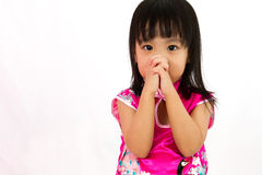 Chinese little girl wearing Cheongsam praying Stock Photo