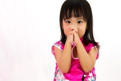 Chinese little girl wearing Cheongsam praying Stock Photo