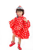 Chinese Little Girl Wearing raincoat and Boots Stock Images