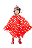 Chinese Little Girl Wearing raincoat and Boots Royalty Free Stock Photo