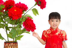 Chinese little girl wearing in Red posing with flowers Stock Images