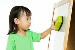 Chinese little girl writing on whiteboard Royalty Free Stock Image