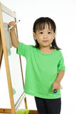 Chinese little girl writing on whiteboard Royalty Free Stock Photo