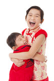 chinese little Girls  and Giving One Another Hug Stock Photo