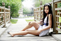 Chinese long-haired girl outdoor Stock Photos