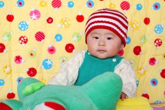 Chinese lovely baby. Climb  cute Royalty Free Stock Images