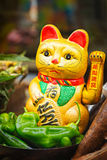 Chinese lucky cats on food market royalty free stock photo