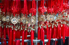 Chinese lucky charms in a shop. Picture of hanging Chinese charms for luck Stock Photo