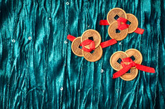 Chinese lucky coins. Background with three sets of three Chinese lucky coins each tied with red ribbon on turquoise velvet fabric. One set of coins shows yin royalty free stock photos