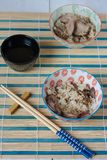 Chinese lunch set with rice and dusck meat, tea Stock Image