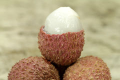 Chinese lychee on white Royalty Free Stock Photos