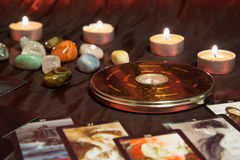 Chinese magnetic compass - Luopan. Moscow, Russia - December 4, 2016: Chinese magnetic compass - Luopan. Tarot cards, candles and minerals. Feng Shui background Stock Image