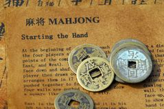 Chinese mahjong and antique coins Royalty Free Stock Images