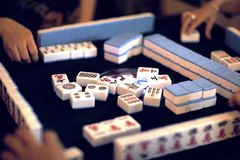 Chinese Mahjong. Friends and relatives gather together to play mahjong in China royalty free stock photo