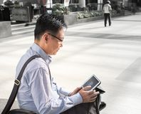 Chinese male adult on ipad Royalty Free Stock Photography