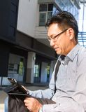 Chinese male adult on ipad Stock Photography