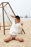Chinese male model. A young chinese male models  in the beach Royalty Free Stock Photos