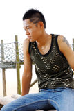 Chinese male model. A young chinese male models  in the beach Stock Image