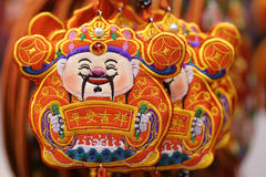 Chinese mammon decorations. The close-up of embroidery of Chinese mammon. The Chinese characters means: peace and auspicious Stock Image