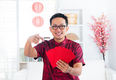 Chinese man and Ang Pow Stock Image