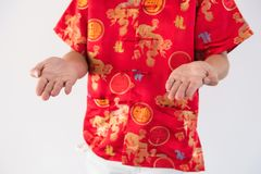 Chinese man ask for money, 2018 new year. Hands of Young Chinese man with red traditional cheongsam costume ask for Ang pao envelope or money with white Stock Images