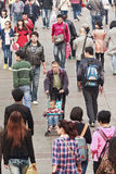Chinese Man with baby-car in Crowd. DALIAN-CHINA-OCT. 14, 2012. Man with child in Crowd on Oct 14, 2012 in Dalian. Chinese think tank urges government phasing Royalty Free Stock Photo
