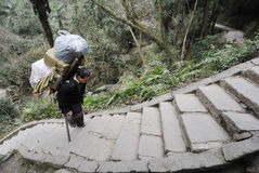 Chinese man carry goods. In the mountains,in Sichuan,China Royalty Free Stock Photos