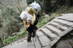 Chinese man carry goods. In the mountains,in Sichuan,China Royalty Free Stock Image