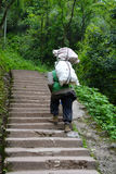 Chinese man carry goods in the mountains. In Sichuan,China Royalty Free Stock Images