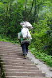 Chinese man carry goods in the mountains. In Sichuan,China Stock Photo