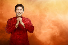 Chinese man in cheongsam suit Royalty Free Stock Photos