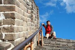 A Chinese man on China Badaling Great Wall. Sit on China Badaling Great Wall Stock Photos