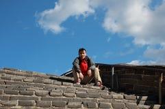 A Chinese man on China Badaling Great Wall. Sit on China Badaling Great Wall Royalty Free Stock Photos