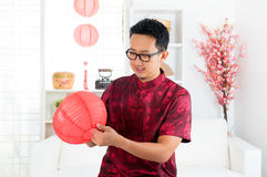 Chinese man decorating house Stock Photos