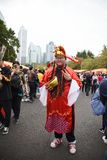 A Chinese man dressed as the god of wealth in China celebrates the Chinese New Year. The god of wealth in China is the object of popular and worship, because royalty free stock image