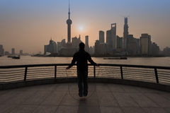 Chinese man exercising jumping rope the bund waterfront shanghai Royalty Free Stock Images