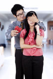 Chinese man giving surprise his girlfriend Royalty Free Stock Image