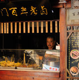 Chinese man at grilled meat food stand stock images