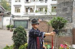 Chinese man holding a fake gun Stock Photo
