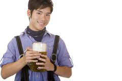 Chinese man holding Oktoberfest beer stein Stock Image