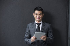 Chinese man holding a tablet computer. Stock Photos