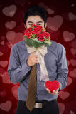 Chinese man holds a gift and flower Royalty Free Stock Photos