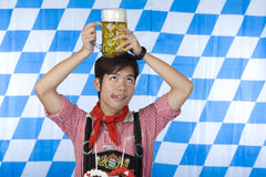 Chinese man Lederhose holds beer stein head Stock Images