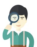 Chinese man with magnifying glass Stock Images