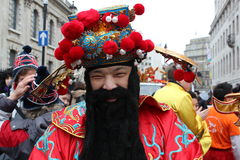 Chinese man in New Year costume. Bearded Chinese man in folklore costume at London Chinese New Year Parade - 29 January 2012 stock photo