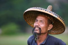 Chinese man in old hat Royalty Free Stock Photos