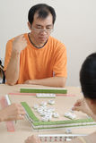 Chinese man play Mahjong Royalty Free Stock Photography
