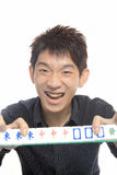 Chinese man play Mahjong Stock Photo